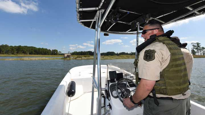 Military bases often allow access to great hunting. Here, U.S. Army Police Officer Sgt. Christopher Griffin, 733rd Security Forces Squadron Game Warden Section conservation law enforcement officer, patrols the waterways along the coast of Joint Base Langley—Eustis in Virginia. (U.S. Air Force image by Senior Airman Delaney Gonzales.)