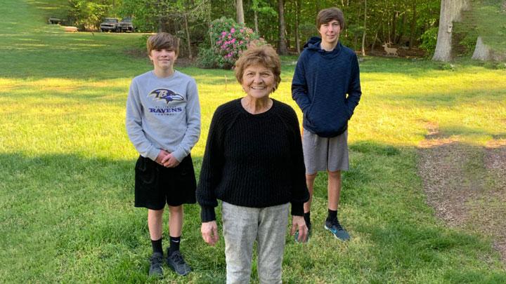 Family social distancing in backyard