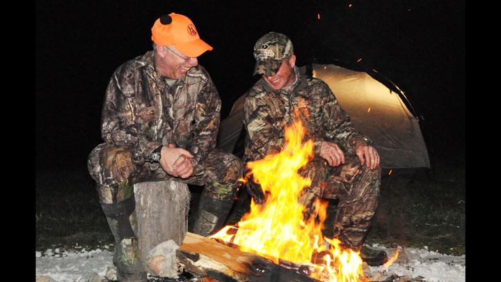 Hunters around campfire