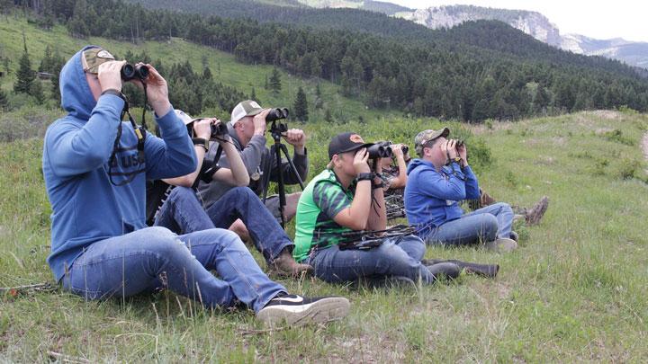 students glassing Montana landscape